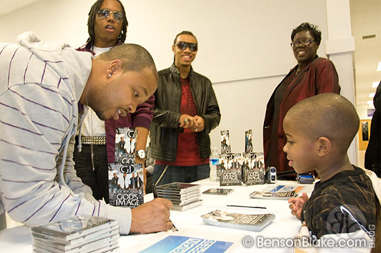 Members of God's Image signing autographs