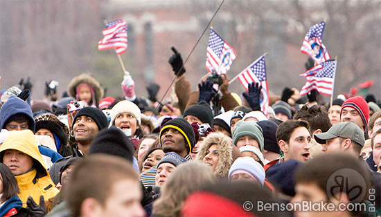 Crowd waving American flags